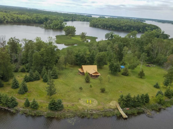 Cabin w/ Private Island Less Than 6 Mi to Sand Valley!